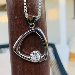 9SQ Stainless Steel and CZ pendant